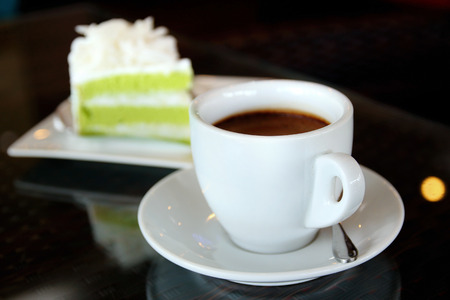 coffeetime: Hot coffee cup and cake on the table