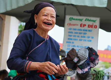 lineage: Ha Giang, Vietnam - September 17, 2015: Hmong senior in Vietnam, She looked at the camera and smiling. In the northern province of Ha Giang in Vietnam. An area adjacent to China. Editorial