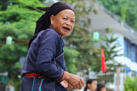 hoary: Ha Giang, Vietnam - September 17, 2015: Hmong senior in Vietnam, She looked at the camera and smiling. In the northern province of Ha Giang in Vietnam. An area adjacent to China. Editorial