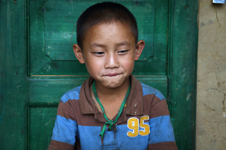 ha giang: Ha Giang, Vietnam - September 19, 2015: Hmong children in Vietnam, In the northern province of Ha Giang in Vietnam. An area adjacent to China.
