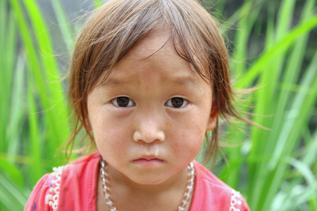 vietnamese ethnicity: Ha Giang, Vietnam - September 20, 2015: Hmong children in Vietnam, In the northern province of Ha Giang in Vietnam. An area adjacent to China. Editorial