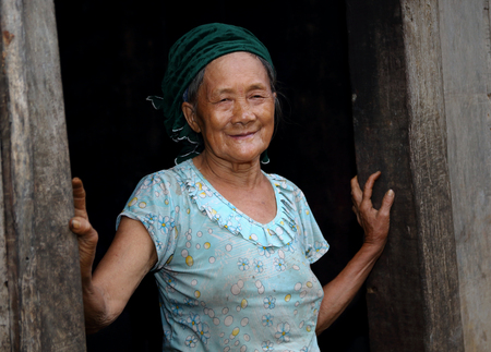 lineage: Ha Giang, Vietnam - September 18, 2015: Hmong senior and black background in Vietnam, In the northern province of Ha Giang in Vietnam. An area adjacent to China.