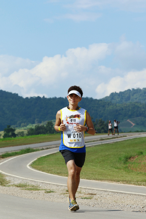 sportsperson: Chiang Rai, Thailand - October 23, 2015: Sunvo Untimate Adventure Challenge 2015. A wilderness adventure racing through trail running, mountain biking, swimming, kayaking and more in the lush jungles.