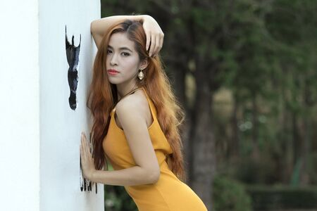 sexy asian woman: Portrait photography, Asian woman in a black dress looking at the camera. Stock Photo