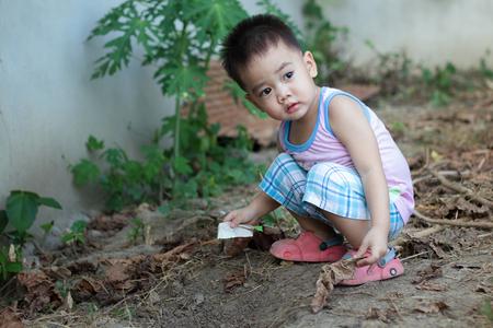 naughty boy: Naughty boy playing on the ground