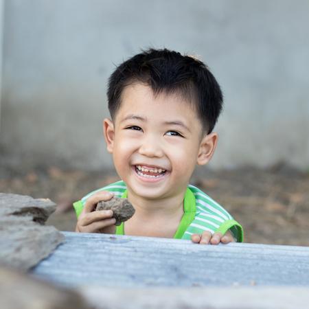 naughty boy: Naughty boy is laughing Stock Photo