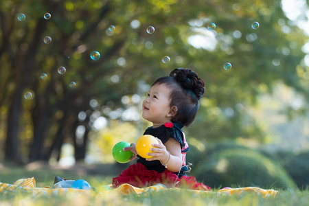hilarity: Asian girl is laughing merrily and the bubble Stock Photo