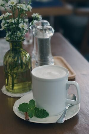 coffeetime: hot milk on the table, vintage tone Stock Photo