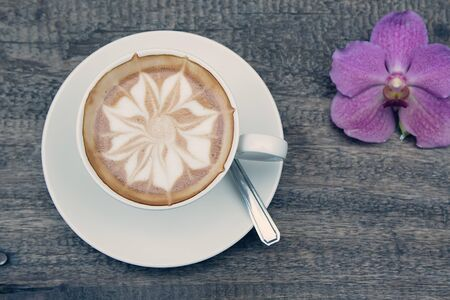 cosiness: Cappuccino, Hot coffee cup on a wooden table, soft focus Stock Photo