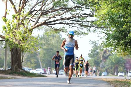 sportsperson: Phetchaburi, Thailand - March 19, 2016: The Amarin Outdoor Unlimited International Triathlon 2016 event at Naresuan Camp, Cha-am beach in Phetchaburi.