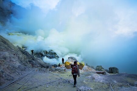 toxicity: Java, Indonesia - April 4, 2016: The workers were carrying sulfur ore in Kawah Ijen Vacano. The Ijen volcano complex is a group of stratovolcanoes in the Banyuwangi Regency of East Java, Indonesia.