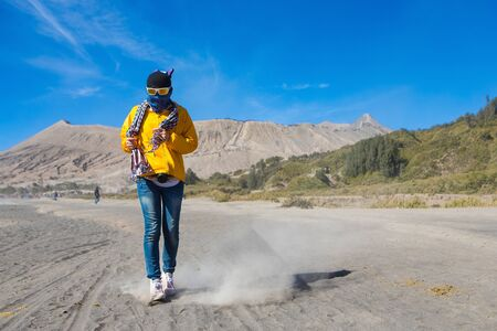 Woman traveler in Mount Bromo, is an active volcano and part of the Tengger massif, in East Java, Indonesia.