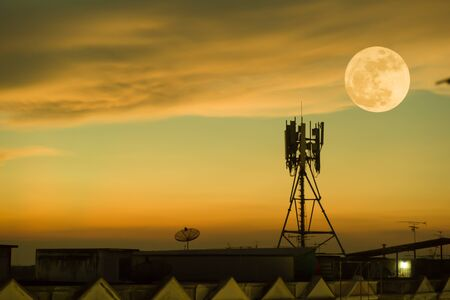 Silhouette telecommunications antenna for mobile phone with the moon. Stock Photo