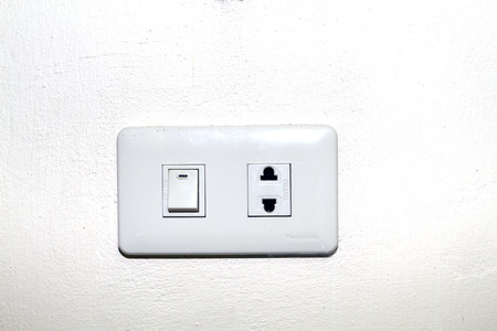 light switch: Close up of a wall light switch in the off position