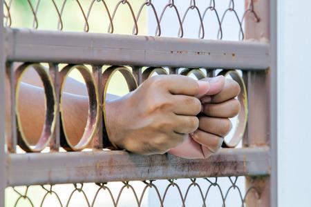 incarceration: Man behind jail bars