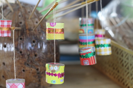 cicada bug: This thai retro toy calling  Jak ka jan  because when swing it. Sound like a cicada bug. It make from bamboo,clay, small rope and color paper.