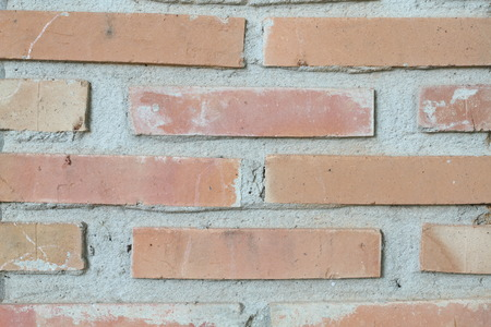 grunge background, red brick wall texture bright plaster wall and blocks road sidewalk abandoned exterior urban background for your concept or project photo