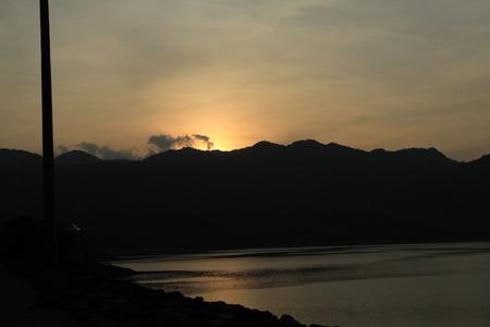 sunset at Srinagarind Dam photo