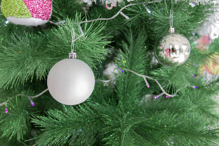 merry chrismas: Christmas decorations gift box and Christmas balls hanging on pine tree and Happy new year for background