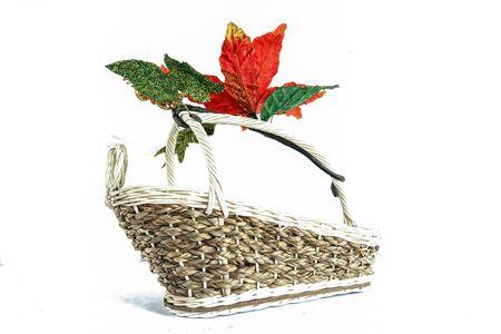 Empty wicker basket with fake flower on white background photo