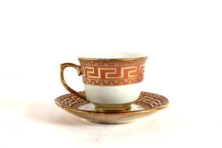 Elegant Antique china tea cup and saucer on white background photo