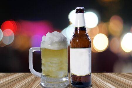 unbottled: Glass of light beer on bokeh background