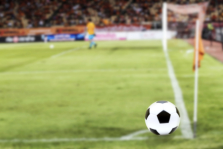 soccer background: Soccer Ball On Green Field of football stadium for background Stock Photo