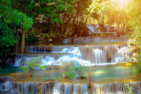 kamin: Huay Mae Kamin Waterfall and wood floor Kanchanaburi Province. Thailand on sunlight