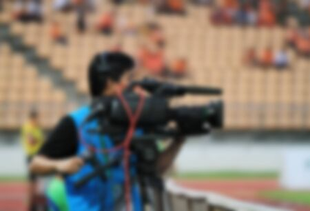 camera operator: blurry of Professional cameraman and Video camera operator working with his professional equipment