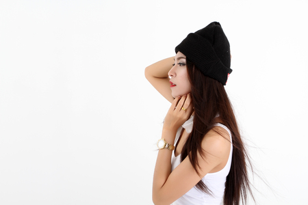 hot asian: Winter Beauty Woman asia Fashion Girl Concept. Skin and hair care in cold season. Beautiful woman with long hair wearing a sweater, scarf, hat and gloves. Holiday Fashion Portrait.on white background Фото со стока