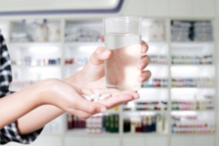 medicine cabinet: Asia women are taking medicines and vitamins for help Sick and healthy on medicine cabinet and store medicine and pharmacy drugstore for background