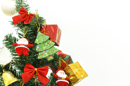 Happy new year and Christmas ornaments on the Christmas tree with gift box and Christmas background