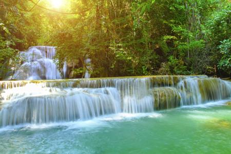Huay Mae Kamin Waterfall and wood floor Kanchanaburi Province. Thailand on sunlight