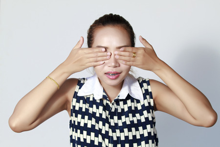 close your eyes: Asian woman hand Close your eyes , because I do not want to hear and know nothing .