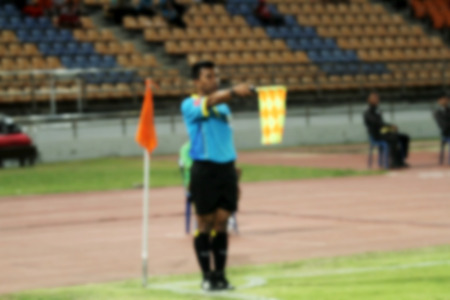 arbitros: blurry Assistant football referee and Referees flag.