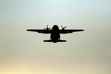boeing: Airplane silhouette flying in the sky ,soft focus and blurry