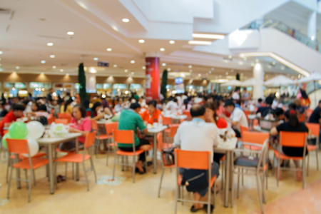 blurry food court at supermarket/mall for background Фото со стока