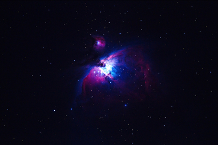 dark nebula: the Great Orion Nebula, M42, NGC1976 on dark night (Deep Sky Objects ),blurry and soft focus. Stock Photo