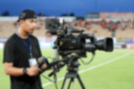 blurry of Professional cameraman and Video camera operator working with his professional equipment