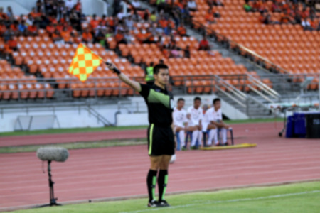 blurry Assistant football referee and Referees flag
