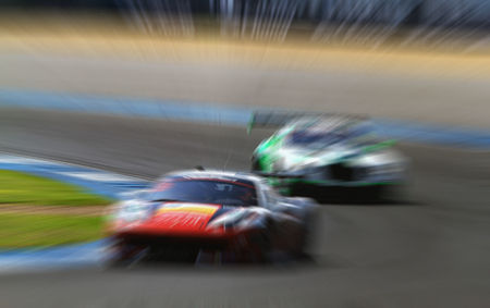indy cars: car racing on the road and track with motion blur and Radial blur