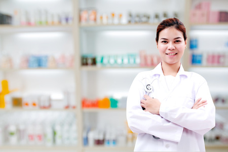 medicine cabinet: pharmacist chemist and medical doctor woman asia with stethoscope and clipboard checking medicine cabinet and pharmacy drugstore .