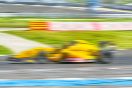 indy cars: HDR car racing on the road and track with motion blur and Radial blur