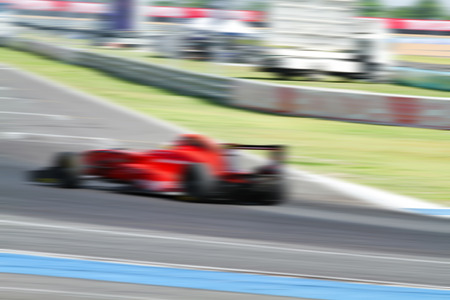 indy cars: Formula 1 car racing on the road with motion blur and Radial blur in racing car track background