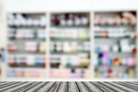 medicine cabinet: blurry medicine cabinet and store medicine and pharmacy drugstore for background with Perspective wood Stock Photo