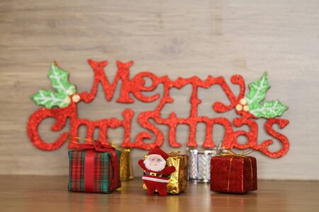 Merry Christmas message on wooden background