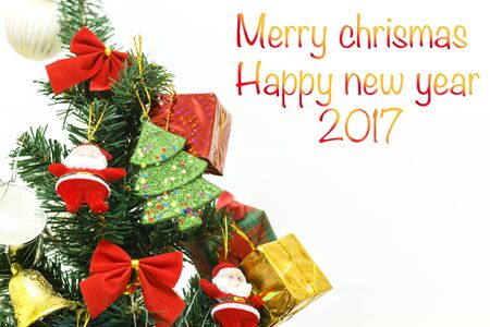 Happy new year 2017 and Christmas ornaments on the Christmas tree with gift box and Christmas background