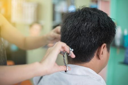 a man cutting hair  at barber