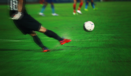 Soft focus and blurry of goalkeeper knocks and kicking the ball for background