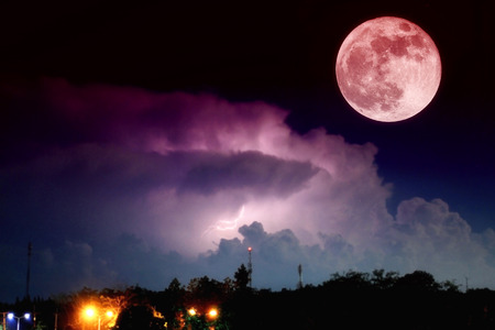 Dramatic: Blood moon and thunder lightnings and storm at dark night background